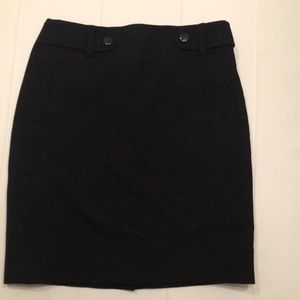 Black wool lined pencil skirt with buttons